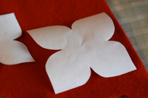 Place cut-out of flower templates on wool with the waxy/shiny side down.